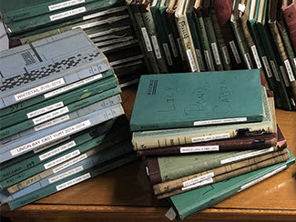 Logbooks from the cabins and yurts at Porcupine Mountains Wilderness State Park are shown.