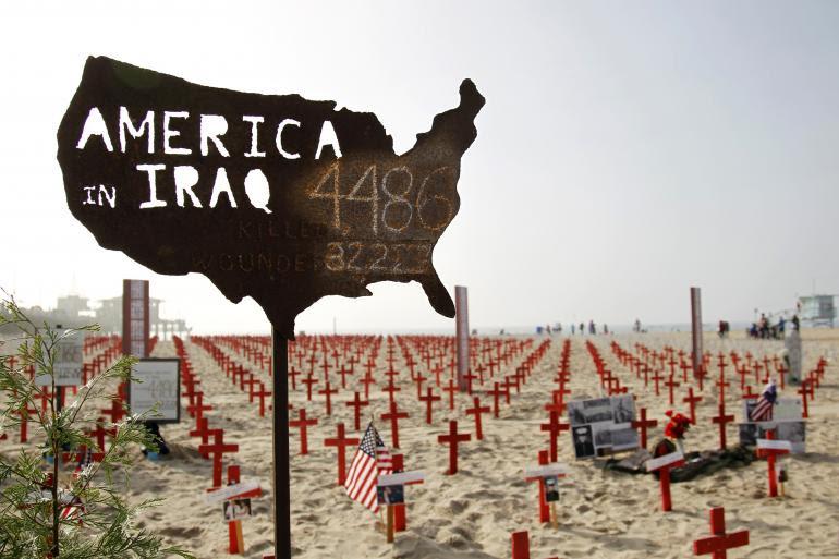 Một bản đồ Mỹ với những con số binh sĩ của quân đội Mỹ thiệt mạng và bị thương ở Iraq được coi là một phần của một đài tưởng niệm tạm thời, được gọi là