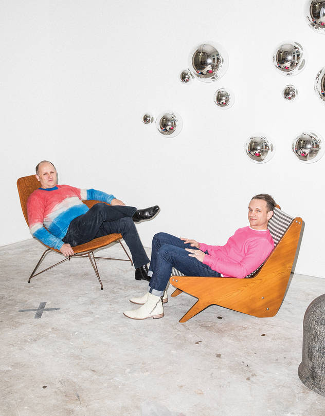 TWO'S COMPANY Zesty Meyers (left) on a 1950s Martin Eisler chair and Evan Snyderman on a 1950s José Zanine Caldas lounger at R & Company's new Tribeca gallery. The wall installation is by Jeff Zimmerman, and the stool is a 1968 design by Pietro Derossi, Giorgio Ceretti and Riccardo Rosso.