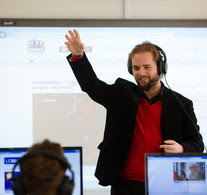 Image of lecturer delivering to students in a language lab.
