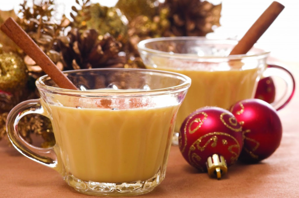 Glasses of festive eggnog with christmas decorations.