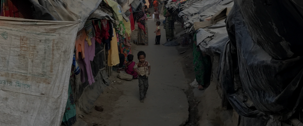 Boy walking through IDP camp