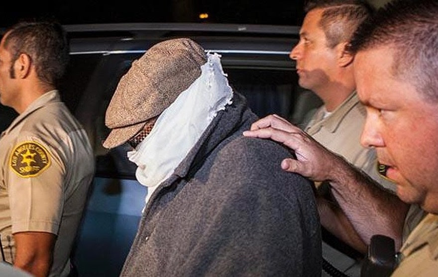 Nakoula Basseley Nakoula, seen here in September being escorted out of his home in Cerritos, Calif., told FoxNews.com he doesn't consider himself as a political prisoner and refused to call himself a scapegoat for the deadly siege that killed four Americans last year in Benghazi, Libya. (Bret Hartman/Reuters)