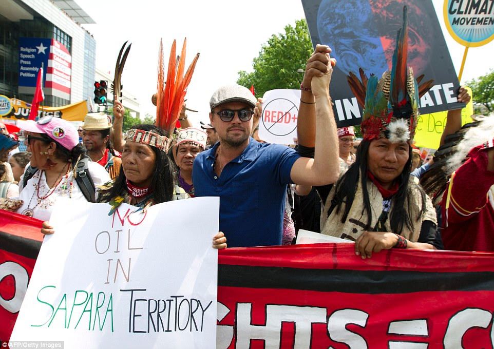 Actor Leonardo DiCaprio joined thousands of climate change protesters in Washington DC to mark President Donald Trump's hundredth day in office
