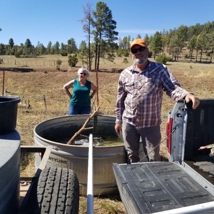 20210612 Lary and Karin filling troughs at Hall tank