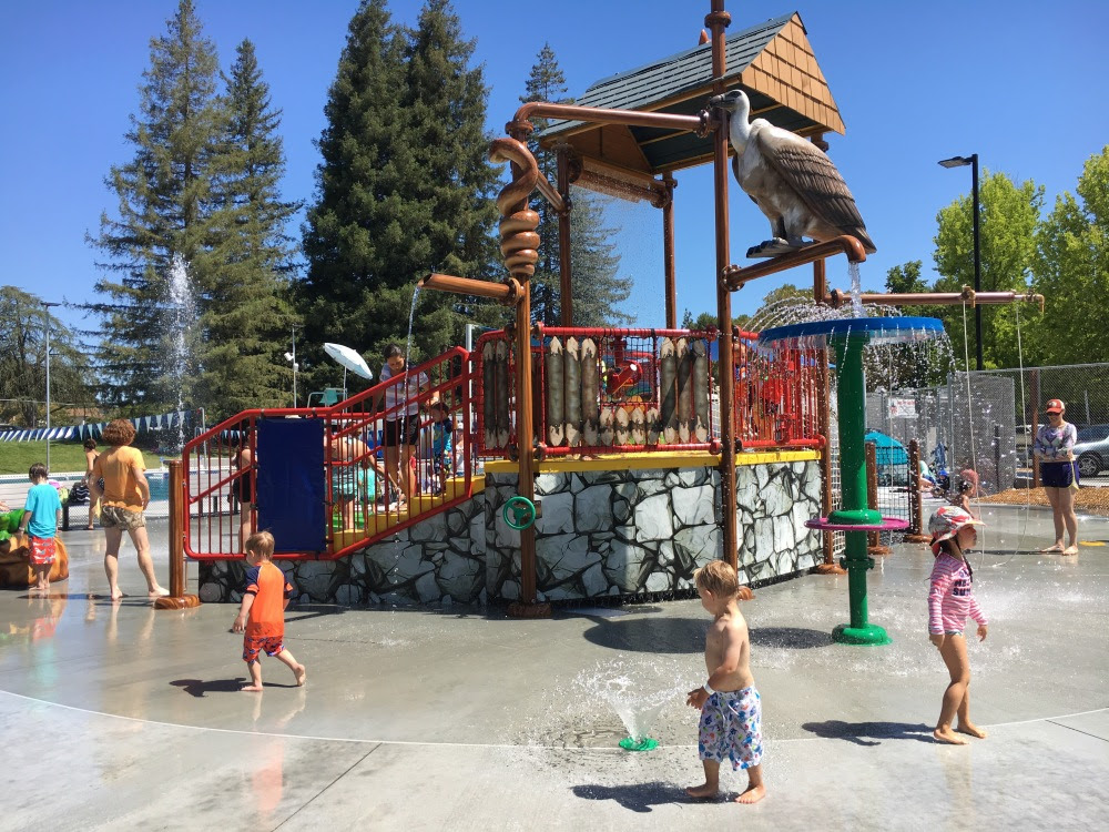 Children playing at covered splash pad