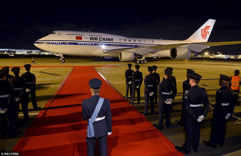 Britain rolls out the red carpet for the Chinese President and his wife after they touched down at Heathrow