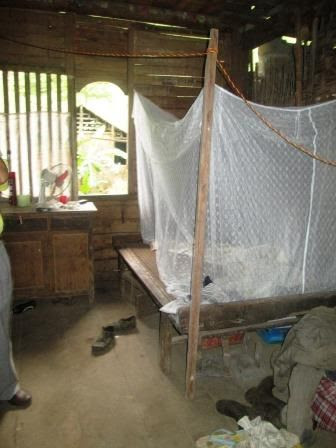 The houses are open to the weather, so they sleep with mosquito nets.