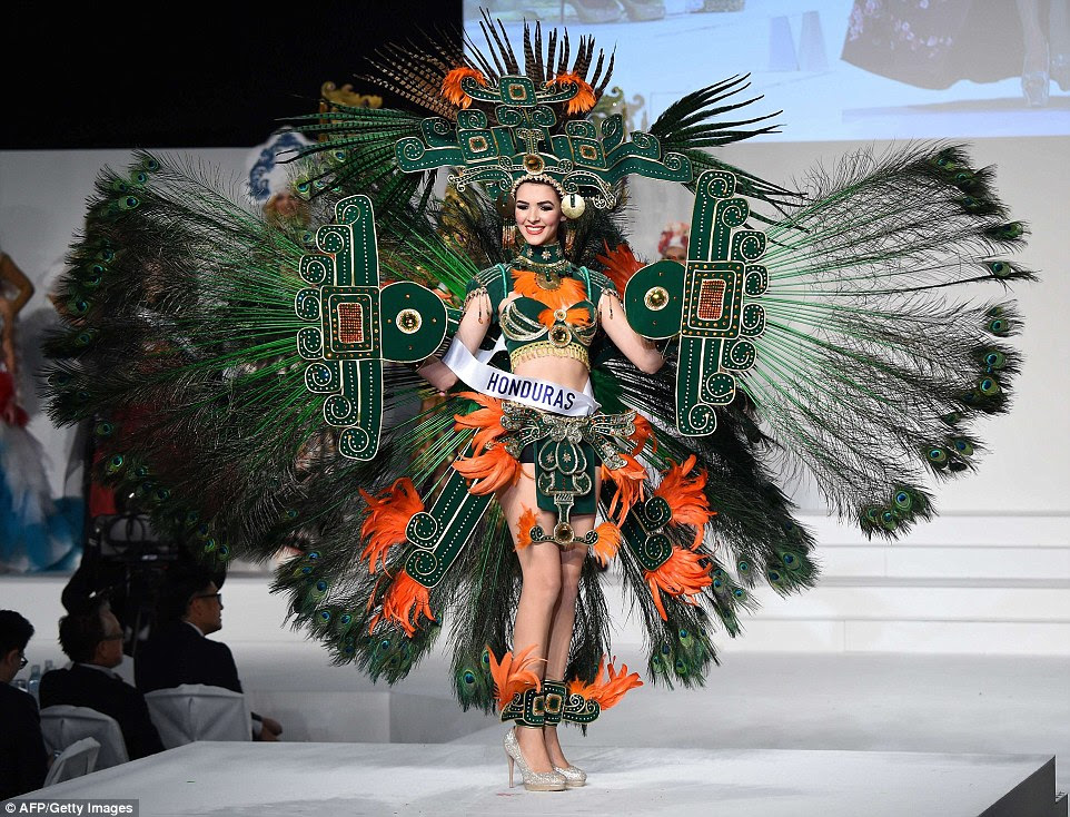 Miss Honduras Jennifer Valle displays her national costume during the Miss International beauty pageant in Tokyo. She opted for peacock feathers for her green and orange outfit, despite the national bird of Honduras being the colourful scarlet macaw