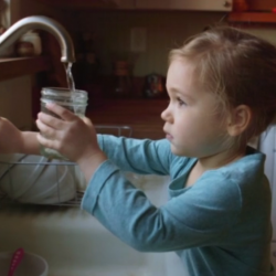 little girl drinking tap water