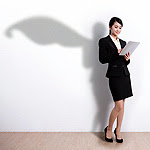 recruiter with tablet casting shadow with superhero cape