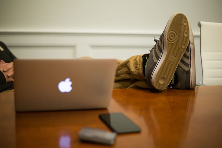 table-office-sneakers-relaxed-worker-reclining.jpg