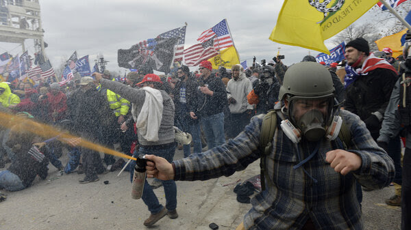 Pro-Trump extremists clashed with police during the storming of the U.S. Capitol on Jan. 6. The rioters may not have fired shots, but many were armed with other weapons, court documents show.
