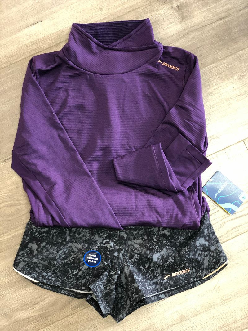 Brooks women's running long sleeve top and shorts.