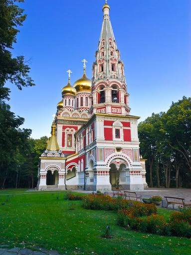 Another                                                           red-colored                                                           church, this                                                           one in Shipka,                                                           Bulgaria, the                                                           Memorial                                                           Temple of the                                                           Birth of                                                           Christ is a                                                           Bulgarian                                                             Orthodox                                                           church built                                                           from 1885 to                                                           1902 and                                                           contains a                                                           12-ton bell in                                                           its tower.