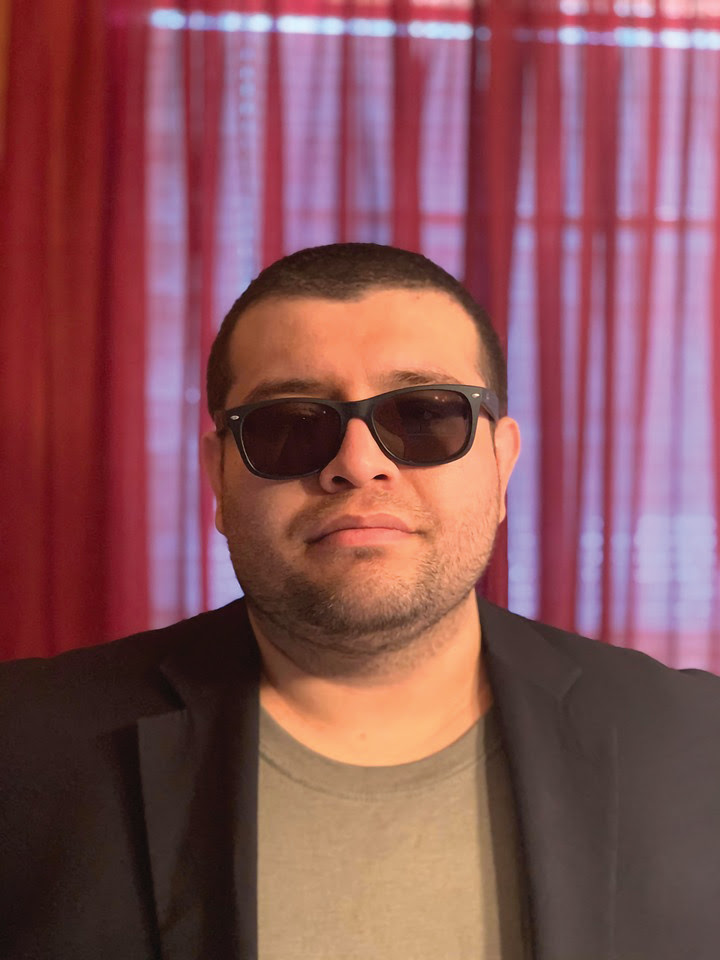 A person wearing sunglasses  Description automatically generated