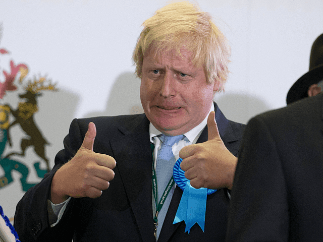 UXBRIDGE, ENGLAND - MAY 08: (Alternate crop of #472458768) Boris Johnson, Conservative candidate for Uxbridge celebrates on stage following his win as he attends the count at Brunel University London on May 8, 2015 in Uxbridge, England. The United Kingdom has gone to the polls to vote for a new …