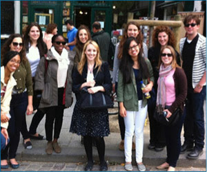Librarian Bill Gillis and Paris students pose in front of the renowned Left Bank Shakespeare and Company bookstore