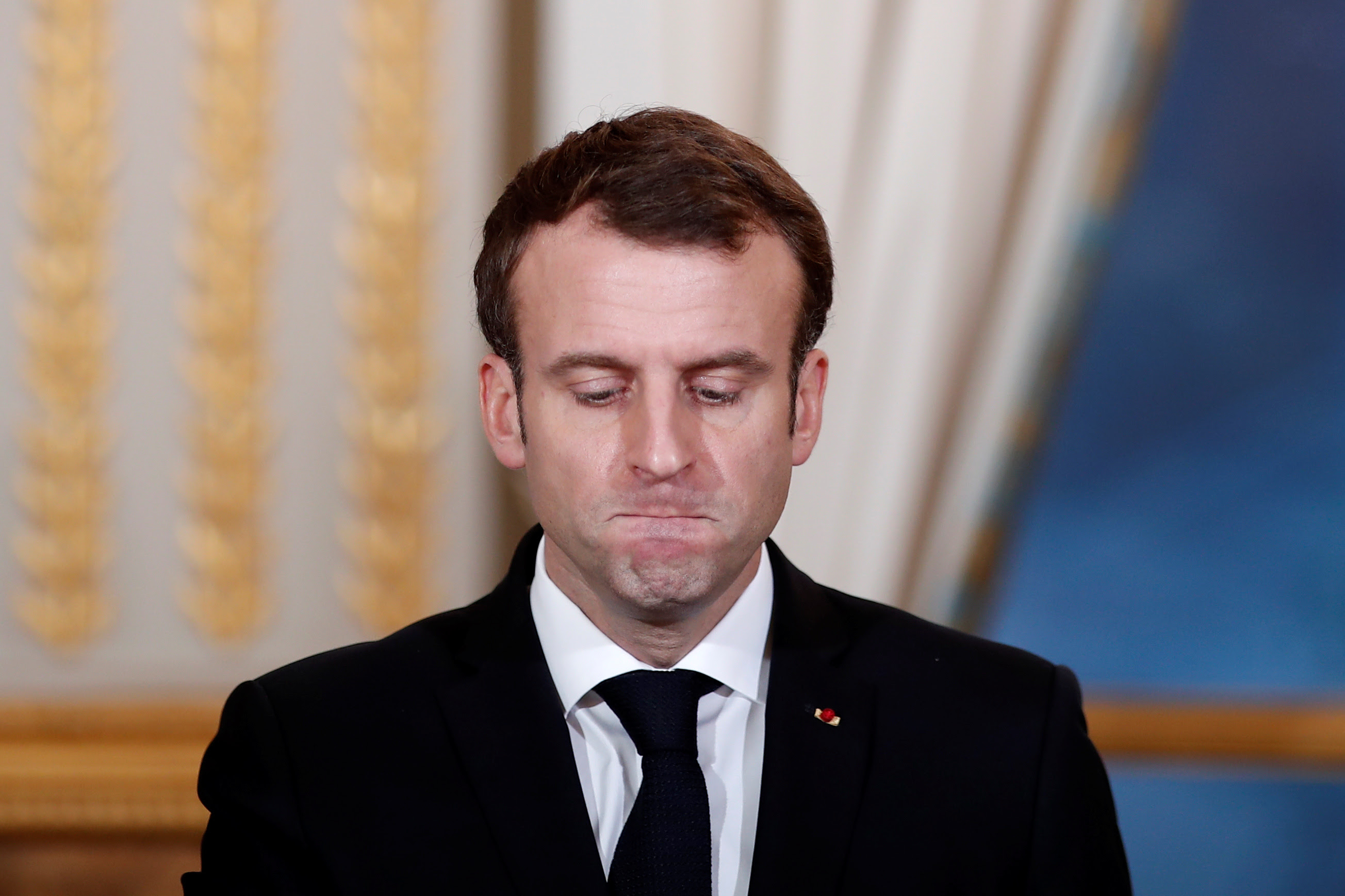 French President Emmanuel Macron attends a joint news conference with President of Burkina Faso Roch Marc Christian Kabore at the Elysee Palace in Paris