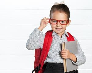 Photograph of a girl with glasses wearing a backpack