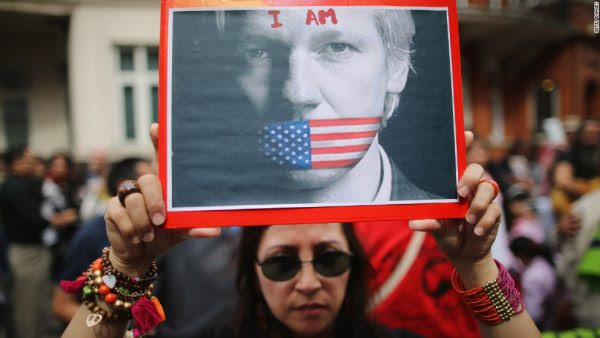 Protest outside Ecuadorean Embassy in London, 2012, CNN.