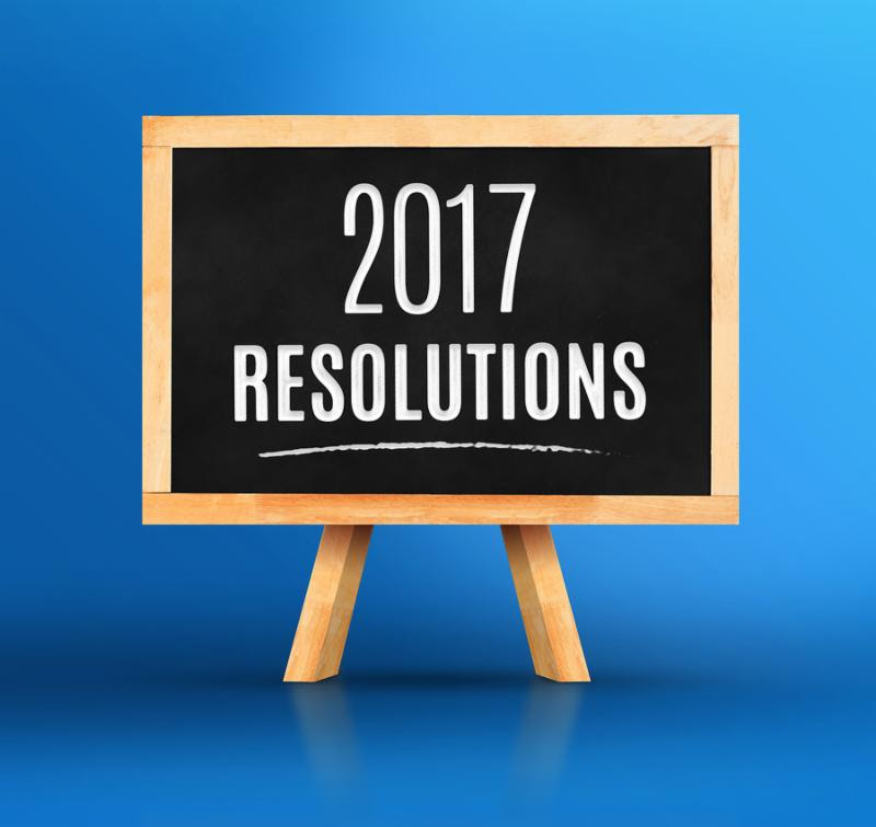 2017 New year s resolutions word on Blackboard with easel on vivid blue studio backdropNew year planning.