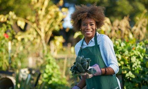 Woman gardening in her yard